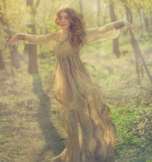 Young woman open in the woods-Open to life-freeing ourselves -forgiveness